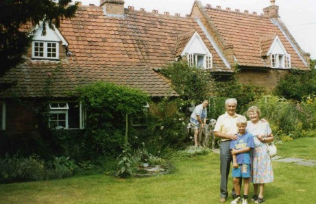 Granddad, my brother James and Gran next to the house she grew up in